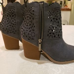 Beautiful heeled booties with flower cutout design